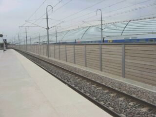 Luc snaps two TGVs crossing at Avignon TGV. A sound barrier partly obscures the TGV on the other line.